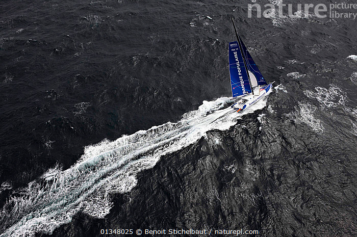 """Aerial view of monohull """"Banque Populaire"""" during training ahead of Transat Jacques Vabre 2011. Lorient, Brittany, France, July 2011. All non-editorial uses must be cleared individually., ADVENTURE,AERIALS,BOATS,CHOPPY,EUROPE,FREEDOM,OPEN 60,RACES,SAILING BOATS,WAKE,YACHTS,CONCEPTS,SAILING-BOATS,core collection xtwox, Benoit Stichelbaut"""