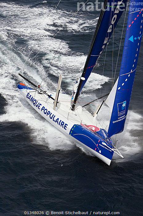 """Monohull """"Banque Populaire"""" during training ahead of Transat Jacques Vabre 2011. Lorient, Brittany, France, July 2011., BOATS,EUROPE,FRONT VIEWS,HIGH ANGLE SHOT,NAMES,OPEN 60,RACES,SAILING BOATS,SPEED,TEXT,VERTICAL,WAKE,YACHTS,SAILING-BOATS, Benoit Stichelbaut"""