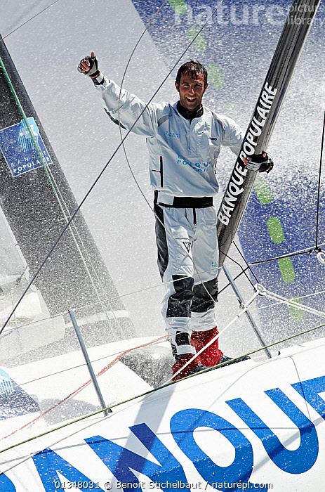 """Skipper Armel Le Cleac'h soaked on board monohull """"Banque Populaire"""" during training ahead of Transat Jacques Vabre 2011. Lorient, Brittany, France, July 2011. All non-editorial uses must be cleared individually., BOATS,CREWS,EUROPE,MAN,OPEN 60,PEOPLE,PORTRAITS,RACES,SAILING BOATS,SPLASHES,SPRAY,VERTICAL,WET,WET WEATHER GEAR,YACHTS,SAILING-BOATS,core collection xtwox, Benoit Stichelbaut"""
