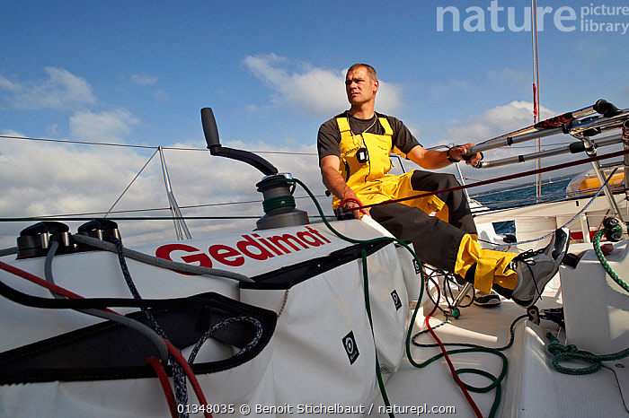 """Skipper Thierry Chabagny helming on board """"Gedimat"""" ahead of La Solitaire du Figaro, Concarneau, France, July 2011. All non-editorial uses must be cleared individually., ABOARD,BOATS,COCKPITS,CONCENTRATION,CREWS,EUROPE,HELMING,LINES,LOW ANGLE SHOT,PROCEDURES,RACES,ROPES,SAILING BOATS,SHEETS,SKIPPER,SOLO,TILLERS,TRIMMING,WINCHES,YACHTS,BOAT-PARTS,core collection xtwox, Benoit Stichelbaut"""