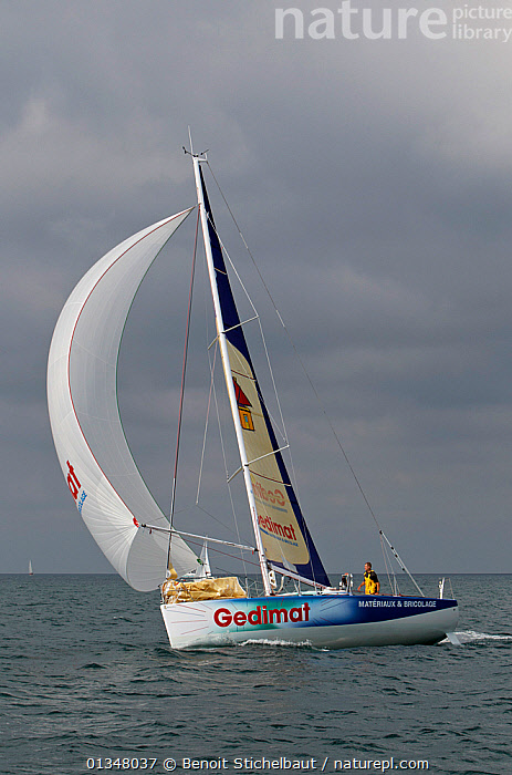 """""""Gedimat"""" under spinnaker ahead of La Solitaire du Figaro, Concarneau, France, July 2011. All non-editorial uses must be cleared individually.  ,  BOATS,CREWS,EUROPE,FORESAILS,MAINSAILS,MAN,NAMES,PEOPLE,PROFILE,RACES,SAILING BOATS,SKIES,SOLO,SPINNAKERS,STORMS,TEXT,VERTICAL,WEATHER,YACHTS,SAILS ,core collection xtwox  ,  Benoit Stichelbaut"""