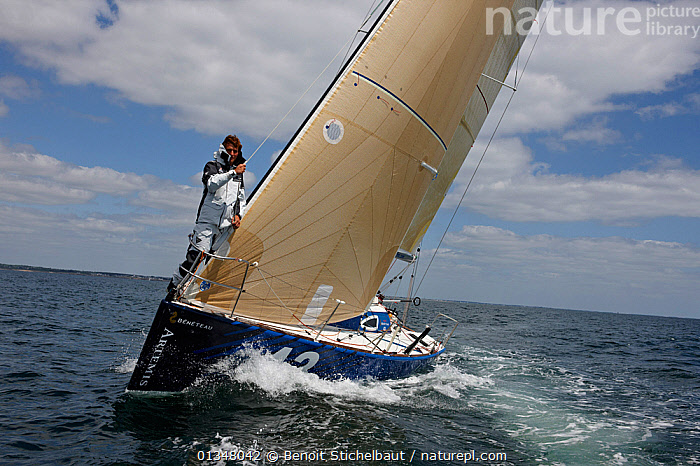 """Skipper Sam Goodchild on the bow of """"Artemis"""" ahead of La Solitaire du Figaro, France, July 2011. All non-editorial uses must be cleared individually., BOATS,BOWS,CREWS,EUROPE,FRONT VIEWS,MAN,MS,PEOPLE,RACES,SAILING BOATS,SKIPPER,SOLO,YACHTS,BOAT-PARTS,core collection xtwox, Benoit Stichelbaut"""