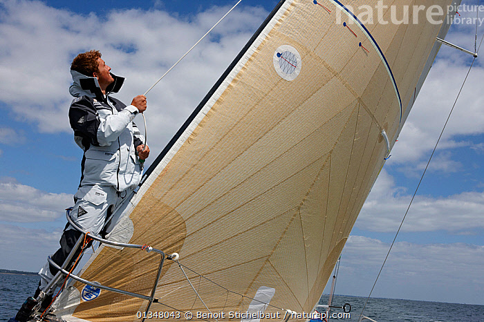 """Skipper Sam Goodchild trimming on board """"Artemis"""" ahead of La Solitaire du Figaro, France, July 2011. All non-editorial uses must be cleared individually., BOATS,BOWS,CREWS,EUROPE,FORESAILS,MAN,MS,PEOPLE,PROCEDURES,RACES,SAILING BOATS,SKIPPER,SOLO,TRIMMING,WET WEATHER GEAR,YACHTS,BOAT-PARTS,core collection xtwox, Benoit Stichelbaut"""