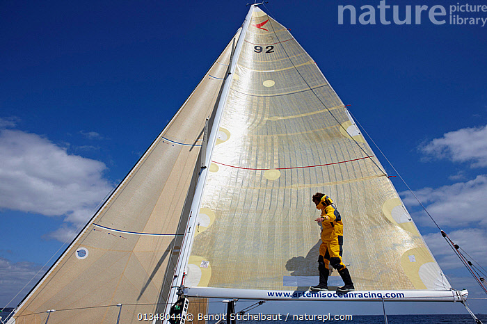 """Skipper Sam Goodchild edging along boom on board """"Artemis"""" ahead of La Solitaire du Figaro, France, July 2011. All non-editorial uses must be cleared individually.  ,  BOATS,BOOMS,CLIMBING,CREWS,EUROPE,FORESAILS,MAINSAILS,MS,PEOPLE,PROFILE,RACES,SAILING BOATS,SKIPPER,SOLO,WET WEATHER GEAR,YACHTS,BOAT-PARTS,SPORTS ,core collection xtwox  ,  Benoit Stichelbaut"""