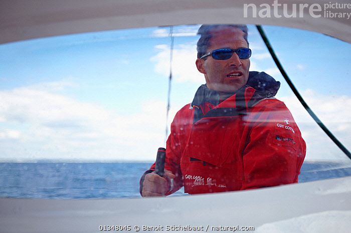 """Philippe Legros on board MOD70 trimaran """"Veolia Environnement"""", Concarneau, Brittany, France, June 2011. All non-editorial uses must be cleared individually.  ,  BOATS,CONCENTRATION,CREWS,EUROPE,HOOD,HOODS,MAN,PEOPLE,PORTRAITS,RACES,SAILING BOATS,SKIPPER,SUNGLASSES,YACHTS  ,  Benoit Stichelbaut"""