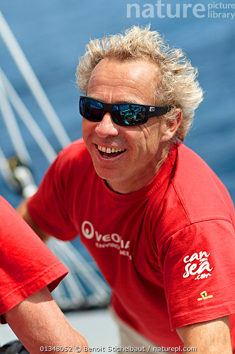 """Portrait of skipper Roland Jourdain on board MOD70 trimaran """"Veolia Environnement"""", Concarneau, Brittany, France, June 2011. All non-editorial uses must be cleared individually., ABOARD,BOATS,CREWS,EUROPE,MAN,MULTIHULLS ,PEOPLE,PORTRAITS,SAILING BOATS,SKIPPER,SMILING,SUNGLASSES,TRIMARANS,VERTICAL,YACHTS,core collection xtwox, Benoit Stichelbaut"""