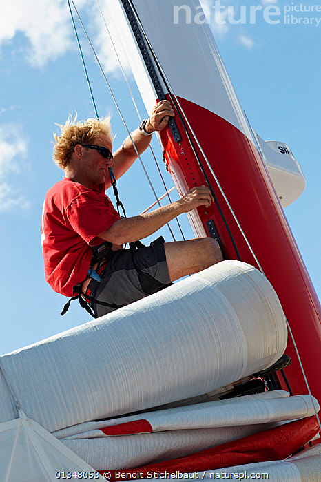 """Sailwork on board MOD70 trimaran """"Veolia Environnement"""", Concarneau, Brittany, France, June 2011. All non-editorial uses must be cleared individually., ABOARD,BOATS,CLIMBING,EUROPE,HARNESSES,MASTS,MULTIHULLS ,PROCEDURES,ROPES,SAILING BOATS,SAILS,TRIMARANS,VERTICAL,YACHTS,SPORTS ,BOAT-PARTS,core collection xtwox, Benoit Stichelbaut"""