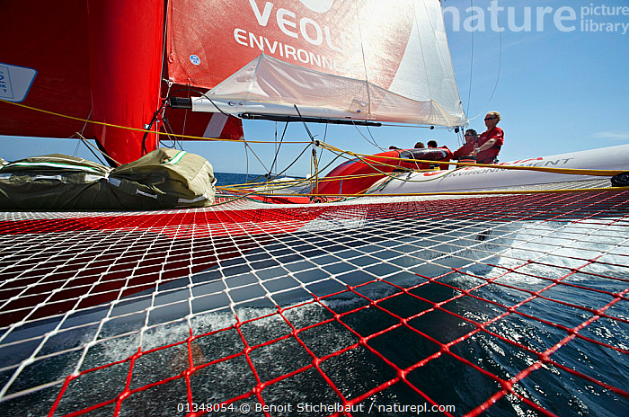 """View across trampoline on board MOD70 trimaran """"Veolia Environnement"""", Concarneau, Brittany, France, June 2011. All non-editorial uses must be cleared individually.  ,  ABOARD,ANGLES,BOATS,CREWS,EUROPE,LOW ANGLE SHOT,MEN,PEOPLE,SAILING BOATS,TRAMPOLINES,TRIMARANS,YACHTS,BOAT-PARTS,core collection xtwox  ,  Benoit Stichelbaut"""