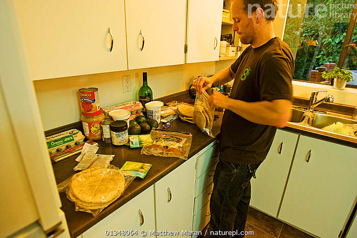 A man preparing food for hiking the West Coast Trail. Pacific Rim National Park, Vancouver Island, Canada, September., BRITISH COLUMBIA,CANADA,COOKING,EXPEDITIONS,FOOD,HIKING,INDOORS,KITCHENS,NORTH AMERICA,NP,PEOPLE,RESERVE,VANCOUVER,WEST CANADA,National Park, Matthew Maran