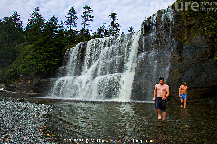 Two men at the foot of a large waterfall. The West Coast Trail, Pacific Rim National Park, Vancouver Island, Canada, September 2010., BRITISH COLUMBIA,CANADA,HIKING,LANDSCAPES,NORTH AMERICA,NP,OUTDOORS,PEOPLE,RESERVE,RIVERS,STREAMS,TOURISM,TWO,VANCOUVER,WATER,WATERFALLS,WEST CANADA,National Park, Matthew Maran