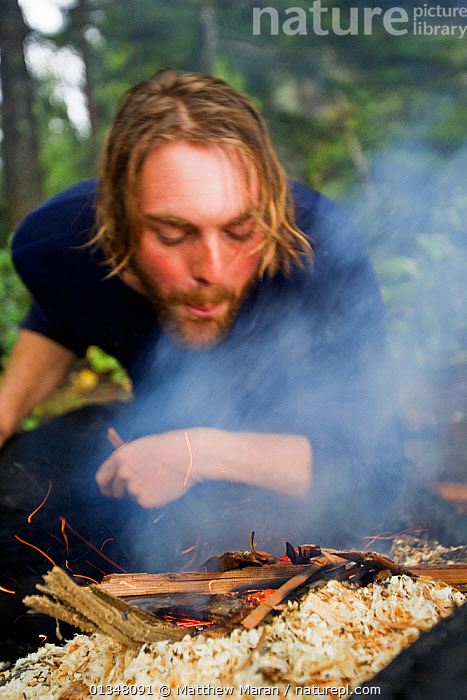A hiker building a fire at his campsite. The West Coast Trail, Pacific Rim National Park, Vancouver Island, Canada, September 2010. Model released., BRITISH COLUMBIA,CAMPING,CANADA,HIKING,NORTH AMERICA,NP,PEOPLE,RESERVE,TOURISM,VANCOUVER,VERTICAL,WEST CANADA,National Park, Matthew Maran