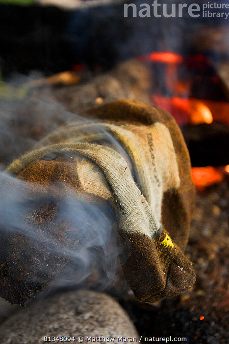 Socks steaming dry by a campfire. The West Coast Trail, Pacific Rim National Park, Vancouver Island, Canada, September 2010., BRITISH COLUMBIA,CAMPING,CANADA,CLOTHES,NORTH AMERICA,NP,RESERVE,SOCKS,VANCOUVER,VERTICAL,WEST CANADA,National Park, Matthew Maran