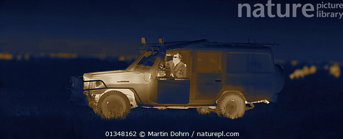 Martin Dohrn in night filming vehicle, on location for National Geographic Nightstalkers, Topi Plain, Masai Mara, Kenya. Image taken using a thermal camera, without artificial light. *THIS IMAGE CAN ONLY BE USED IF NATIONAL GEOGRAPHIC NIGHTSTALKERS IS REFERENCED*, AMMONITE,CAR,CREW,DARK,DRIVING,NIGHT VISION,PEOPLE,PRODUCTION,TEMPERATURE, Martin Dohrn