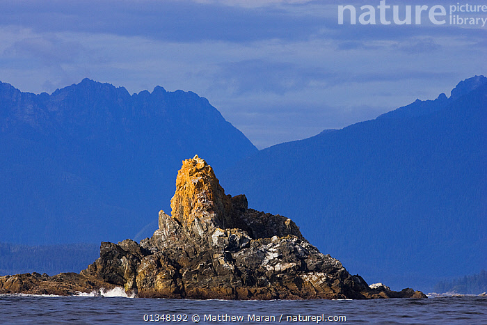 A secluded island in front of coastal mountains.  Sail Rock, The Broken Groups Islands, Barkley Sound, Vancouver Island, Canada, September 2009., BRITISH COLUMBIA,CANADA,CLIFFS,COASTS,ISLANDS,LANDSCAPES,MOUNTAINS,NORTH AMERICA,ROCKS,SEA,SEASCAPES,VANCOUVER,VANCOUVER BOOK,WEST CANADA,Geology, Matthew Maran