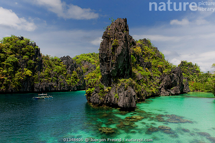 Outrigger boat in Big Lagoon, with its karst limestone cliffs, emerald waters and shallow coral reefs in the white sand. North Palawan, Philippines, May 2009.  ,  BOATS,CLIFFS,COASTAL WATERS,COASTS,CORAL TRIANGLE,CORAL REEFS,INDO PACIFIC,ISLANDS,LANDSCAPES,SOUTH EAST ASIA,TROPICAL,,Geology,SOUTH-EAST-ASIA,Asia  ,  Jurgen Freund
