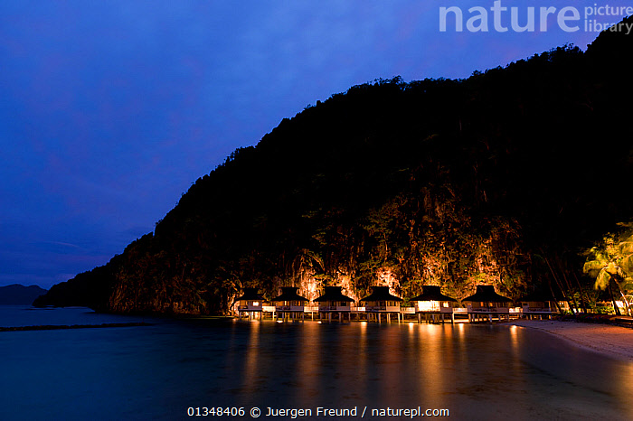 Miniloc Island Resort at dusk. El Nido, Palawan, Phillipines, May 2009.  ,  ASIA,BUILDINGS,CORAL TRIANGLE,DUSK,INDO PACIFIC,ISLANDS,LANDSCAPES,LIGHTS,REFLECTIONS,RESORTS,SILHOUETTES,SOUTH EAST ASIA,  ,  Jurgen Freund