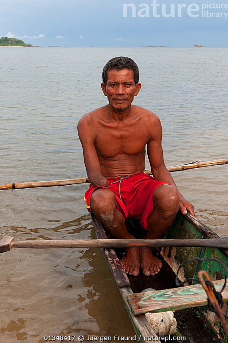 A fisherman who lost his arm dynamite fishing. Palawan, Phillipines, May 2009.  ,  AMPUTATION,AMPUTEE,ASIA,BOATS,CANOES,COASTAL WATERS,CORAL TRIANGLE,CULTURES,DANGEROUS,DUGOUT,DUGOUTS,FISHING,ILLEGAL,INDO PACIFIC,INJURIES,ISLANDS,MEN,MS,OUTRIGGERS,PEOPLE,SITTING,SOUTH EAST ASIA,TRADITIONAL,TROPICAL,VERTICAL,WOODEN,,OPEN-BOATS  ,  Jurgen Freund