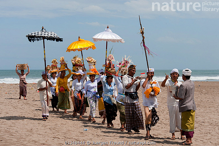 A melasti near one of Bali's most sacred Hindu temples, Pura Petitenget. This religious ceremony, meaning 'to purify', can be performed in a lake, river, spring, or the ocean. Followers pray to their deities to let misery, sin, and other afflictions drift away. Every area has a characteristic way of performing the ritual. Seminyak, Bali, September 2009 . NOT AVAILABLE FOR MAGAZINE USE IN GERMAN-SPEAKING COUNTRIES UNTIL 1ST JULY 2013., ASIA,BEACHES,CEREMONIES,COASTS,CORAL TRIANGLE,CULTURES,GROUPS,INDO PACIFIC,MEN,PARADES,PARASOLS,PEOPLE,RELIGIONS,RITUALS,SOUTH EAST ASIA,WOMEN,,INDONESIA,SOUTH-EAST-ASIA, Jurgen Freund