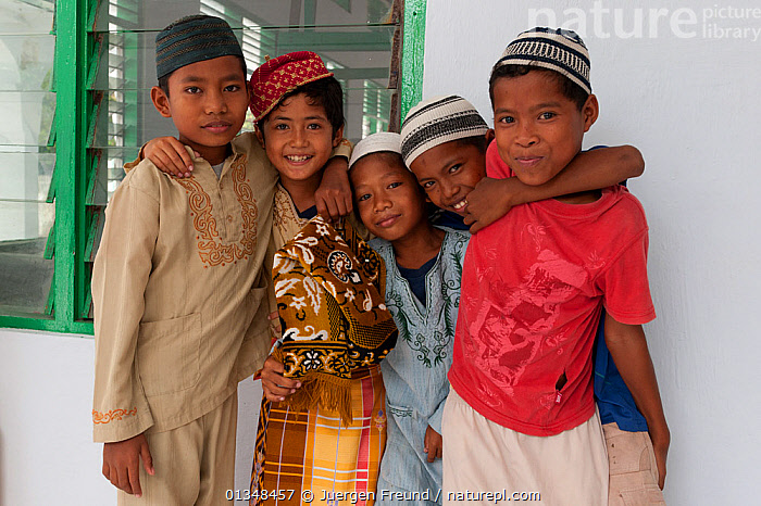 Muslim boys in their prayer clothing outside the mosque in Binongko. Wakatobi, Sulawesi, Indonesia, November 2009.  ,  ASIA,BUILDINGS,CHILDREN,CORAL TRIANGLE,CULTURES,FOUR,GROUPS,HAPPY,INDO PACIFIC,ISLAM,MOSQUES,RELIGIONS,SMILING,SOUTH EAST ASIA,TAQIYAH,  ,  Jurgen Freund
