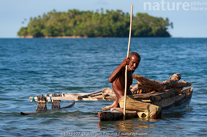 Old man of the of M'buke community gathering firewood for his home in a small traditional outrigger canoe. New Ireland, Papua New Guinea, June 2010., ASIA,BOATS,CANOES,COASTAL WATERS,COLLECTING,CORAL TRIANGLE,CULTURES,DUGOUT,DUGOUTS,FISHING BOATS,INDO PACIFIC,ISLANDS,MEN,OLD,OUTRIGGERS,PEOPLE,SOUTH EAST ASIA,TRADITIONAL,TROPICAL,WOOD,WOODEN,WORKING BOATS,,OPEN-BOATS, Jurgen Freund