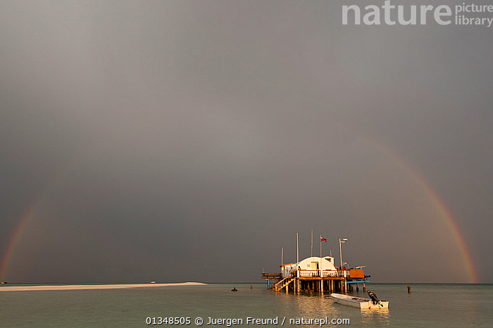 Tubbataha Reef ranger station in a storm with a full arch rainbow against the dark clouds. Tubbataha Reef National Marine Park, Palawan, Philippines, April 2009., ASIA,BEACHES,BOATS,BUILDINGS,CLOUDS,COASTAL WATERS,CONSERVATION,CORAL TRIANGLE,GREY,INDO PACIFIC,RAINBOWS,RANGERS,SHALLOWS,SOUTH EAST ASIA,TROPICAL,,Weather,SOUTH-EAST-ASIA, Jurgen Freund
