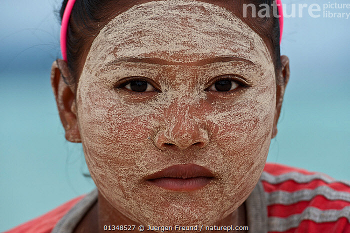 A young Bajau woman with burak (face makeup), a paste made from pounded rice and tumeric which also serves as a natural sunblock. Wearing burak signifies the young lady is single and available for marriage. Sibuan Island, Malaysia, June 2009.  ,  ADORNMENT,ASIA,CORAL TRIANGLE,COSMETICS,CULTURES,FACES,INDO PACIFIC,ISLANDS,MAKE UP,PEOPLE,PORTRAITS,SOUTH EAST ASIA,TRADITIONAL,WOMEN,,YOUNG  ,  Jurgen Freund