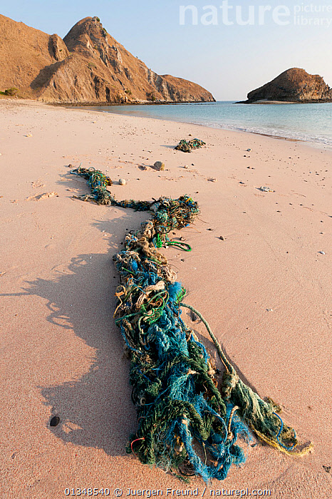 Discarded ropes and fishing tackle strewn along the shoreline on a beach, Komodo island, Indonesia, August 2009., BEACHES,COASTS,CORAL TRIANGLE,FISHING NETS,INDONESIA,INDO PACIFIC,POLLUTION,RESERVE,ROPE,SOUTH EAST ASIA,,SOUTH-EAST-ASIA,Asia,,NP,Komodo National Park,UNESCO World Heritage Site,, Jurgen Freund