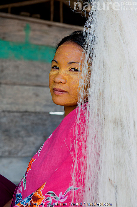 A young Bajau woman with burak (face makeup), a paste made from pounded rice and tumeric which also serves as a natural sunblock. Wearing burak signifies the young lady is single and available for marriage. Sibuan Island, Malaysia, June 2009 . NOT AVAILABLE FOR MAGAZINE USE IN GERMAN-SPEAKING COUNTRIES UNTIL 1ST JULY 2013.  ,  ADORNMENT,ASIA,CORAL TRIANGLE,COSMETICS,CULTURES,INDO PACIFIC,ISLANDS,MAKE UP,PEOPLE,PORTRAITS,SMILING,SOUTH EAST ASIA,TRADITIONAL,VERTICAL,WOMEN,,YOUNG  ,  Jurgen Freund
