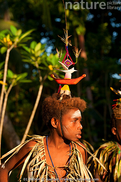 A sing-sing performance, known as laklakau in the Tigak language, by Enuk villagers.The sing-sing is performed as a celebration on many occasions, including at the end of a school year, as thanksgiving, or when an important person comes to visit the village. Kavieng, Papua New Guinea, June 2010 . NOT AVAILABLE FOR MAGAZINE USE IN GERMAN-SPEAKING COUNTRIES UNTIL 1ST JULY 2013.  ,  ASIA,CELEBRATIONS,COLOURFUL,CORAL TRIANGLE,CULTURES,HEADDRESS,INDO PACIFIC,ISLANDS,MAN,MEN,PEOPLE,SOUTH EAST ASIA,TRADITIONAL,VERTICAL,  ,  Jurgen Freund