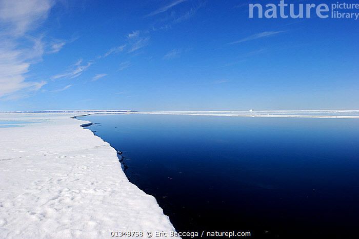 Melting ice at Floe Edge, Arctic Bay, Baffin Island, Nunavut, Canada, April 2009., ARCTIC,Arctic bay,Baffin Island,BLUE,blue sky,CALM,CANADA,catalogue4,environmental concern,Floe edge,global warming,ICE,ICEBERGS,icescapes,LANDSCAPES,melting,Nobody,NORTH AMERICA,Nunavut,PEACEFUL,perspective,POLAR,Scenic,sea,seascapes,simplicity,SKY,sparse,tranquil,vanishing point,WATER,water surface, Eric Baccega
