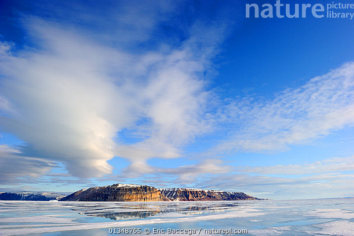 Icepack, cliffs and melting icepack in spring. Arctic Bay, Baffin Island, Nunavut, Canada, June., ARCTIC,CANADA,CLOUDS,COASTS,GLOBAL WARMING,ICE,ICESCAPES,LANDSCAPES,MOUNTAINS,NORTH AMERICA,POLAR,SEASCAPES,SKIES,Weather, Eric Baccega