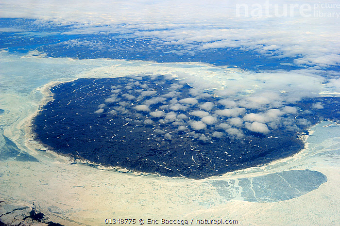 Aerial view of land and icepack in spring. Baffin Island, Nunavut, Canada, June., AERIALS,ARCTIC,CANADA,COASTS,ICE,LANDSCAPES,NORTH AMERICA,POLAR, Eric Baccega