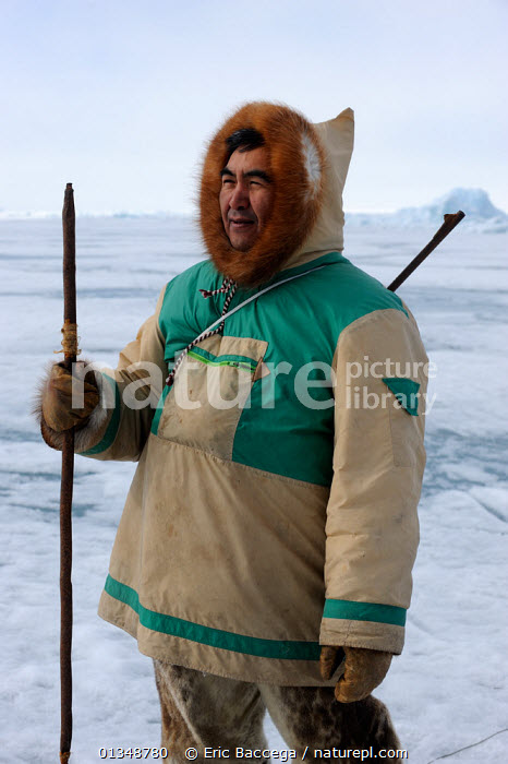 Portrait of Inuit hunter on icepack. Floe Edge, Arctic bay, Baffin Island, Nunavut, Canada, June 2011., ARCTIC,CANADA,HUNTERS,NORTH AMERICA,OUTDOORS,PEOPLE,PORTRAITS,TRADITIONAL,TRIBES,VERTICAL, Eric Baccega
