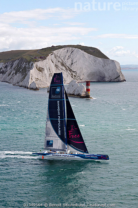 Maxi-trimaran 'Banque Populaire V' passing the Needles Lighthouse during the RORC Rolex Fastnet Race. Isle of Wight, England, August 2011. All non-editorial uses must be cleared individually., AERIALS,BOATS,BUILDINGS,CLIFFS,COASTS,ENGLAND,EUROPE,FORESAILS,LANDSCAPES,LIGHTHOUSES,MAINSAILS,MAXI,MULTIHULLS ,PROFILE,RACES,SAILING BOATS,TRIMARANS,UK,VERTICAL,YACHTS,Geology,United Kingdom,core collection xtwox, Benoit Stichelbaut