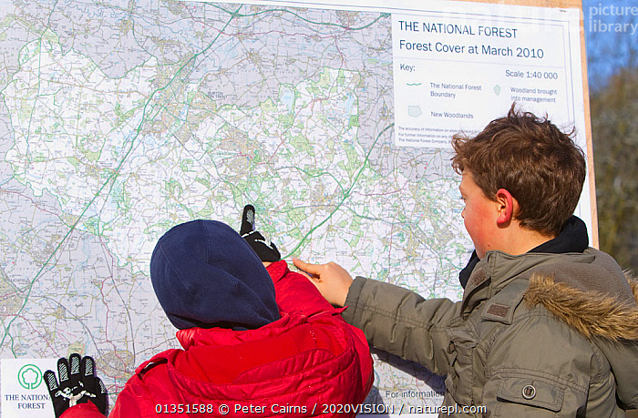 Two boys looking at map of The National Forest, Moira, Derbyshire, UK, November 2010  ,  2020VISION,Boy,COLD,ENGLAND,EUROPE,FORESTS,information,LEISURE,Map,maps,Midlands,outdoors,pca_1_210411_39,PEOPLE,SIGNS,snow frost,The National Forest,two,UK,WINTER,WOODLANDS,United Kingdom  ,  Peter Cairns / 2020VISION