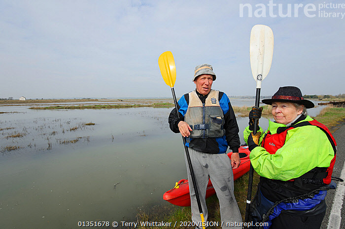 Participants in a Kayak event to canoe around Wallasea Island organised by the RSPB and Burnham-on-Sea Yacht Club. Essex, UK, January 2011  ,  2020VISION,BOATS,CANOES,COASTS,ENGLAND,EUROPE,KAYAKING,KAYAKS,LEISURE,PEOPLE,RESERVE,SALTMARSHES,TWH_200311_0050,UK,URBAN,WATER,WETLANDS,OPEN-BOATS,SPORTS,WATERSPORTS,United Kingdom  ,  Terry Whittaker / 2020VISION
