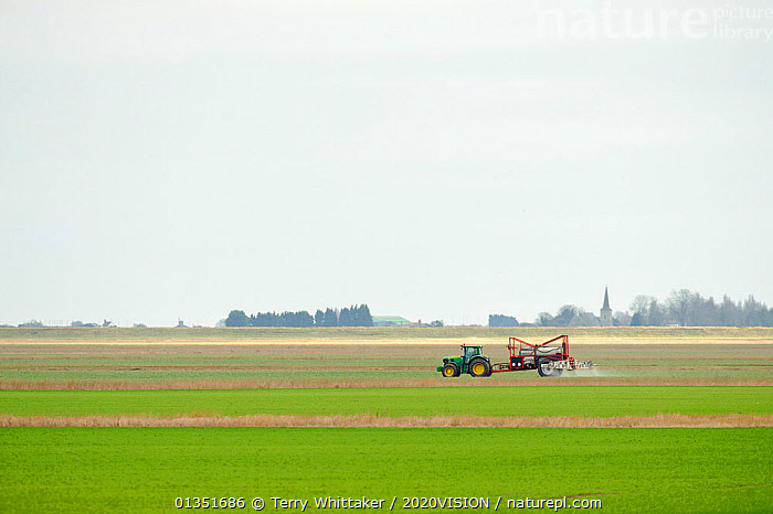 Crop spraying arable land, Wallasea Island Farm, Essex, UK, March 2011  ,  2020VISION,AGRICULTURE,COASTS,CROPS,ENGLAND,EUROPE,GREEN,LANDSCAPES,MACHINERY,RESERVE,TRACTOR,TWH_300111_0004,UK,URBAN,WETLANDS,United Kingdom  ,  Terry Whittaker / 2020VISION