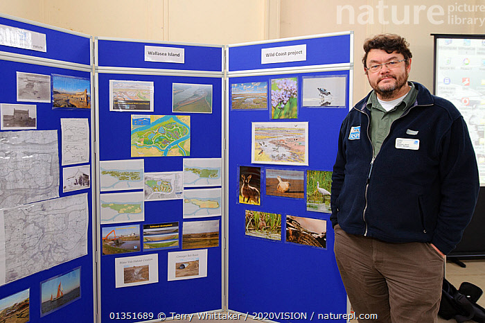 An event to introduce the local community to the RSPB Wallasea Wild Coast Project. Project manager, Chris Tyas, explains the project to visitors and the plans for the future of Wallasea Island, Essex, UK, January 2011, Model released  ,  2020VISION,COASTS,CONSERVATION,EDUCATION,ENGLAND,EUROPE,INDOORS,MAN,PEOPLE,RESERVE,SIGNS,TWH_300111_0011,UK,URBAN,WETLANDS,United Kingdom  ,  Terry Whittaker / 2020VISION