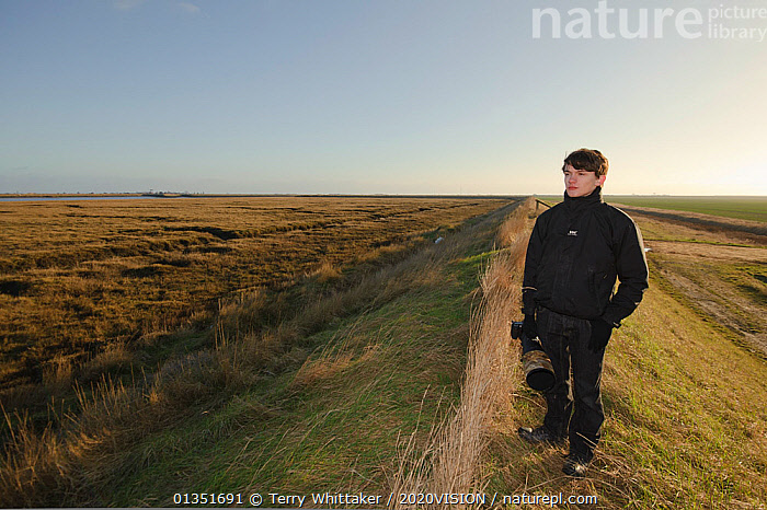 An event to introduce the local community to the RSPB Wallasea Wild Coast Project. Photographer on a trip out to Wallasea Island where volunteers showed the birdlife to visitors and explained the plans for the future of Wallasea Island, Essex, UK, January 2011  ,  2020VISION,COASTS,ENGLAND,EUROPE,LANDSCAPES,MAN,OUTDOORS,PEOPLE,PHOTOGRAPHY,RESERVE,SALTMARSHES,TWH_300111_0016,UK,URBAN,WETLANDS,United Kingdom  ,  Terry Whittaker / 2020VISION