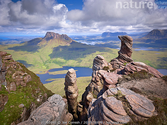View from summit of Sgorr Tuath, sandstone pinnacles, Assynt mountains, Highland, Scotland, UK, June 2011. 2020VISION Exhibition. 2020VISION Book Plate. Did you know? Despite being one of the most northerly areas of the UK these mountains lie in an area called Sutherland, meaning southern land.  ,  2020VISION,2020vision book plate,2020vision exhibition,EROSION,EUROPE,exhibition,GEOLOGY,HIGHLANDS,LANDSCAPES,loch lurgain,MOUNTAINS,press image,picday,publicity image,ROCKS,SCOTLAND,Suilven,UK,United Kingdom,2020cc  ,  Joe Cornish / 2020VISION