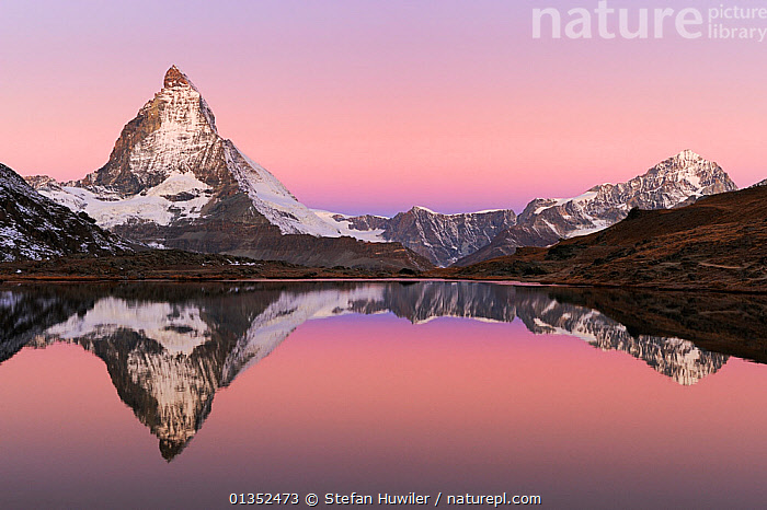 Matterhorn at sunrise in autumn with reflection in the Riffelsee. Zermatt, Valais, Switzerland, Europe, October 2008.  ,  ALPINE,AUTUMN,beauty in nature,CALM,catalogue4,DRAMATIC,EUROPE,LAKES,LANDSCAPES,Matterhorn,MOUNTAINS,nature,Nobody,PEACEFUL,PINK,reflection,REFLECTIONS,Riffelsee,Scenic,SNOW,snow capped,Switzerland,tranquil,travel destination,Valais,WATER,water surface,WINTER,Zermatt,CONCEPTS,,Pastel,  ,  Stefan Huwiler
