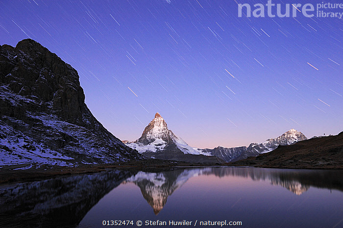 Matterhorn at sunrise in autumn with reflection in the Riffelsee and star-trails. Zermatt, Valais, Switzerland, Europe, October 2008.  ,  ALPINE,BEAUTY IN NATURE,CALM,DRAMATIC,EUROPE,LAKES,LANDSCAPES,LONG EXPOSURE,MOUNTAINS,NIGHT,PEACEFUL,REFLECTIONS,SNOW,STARS,STARTRAILS,SWITZERLAND,WATER,CONCEPTS  ,  Stefan Huwiler