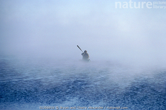 Inuit hunter paddling boat through frost smoke. Igloolik, Nunavut, Canada, 1990. 40 BELOW bookplate., ARCTIC,BOATS,CANADA,COLD,FORTY BELOW BOOK,MIST,NORTH AMERICA,OARS,OBSCURED,OPEN BOATS,PEOPLE,POLAR,SILHOUETTES,SMALL,TRADITIONAL,TRIBES,WEATHER,BOAT-PARTS,SIZE, Bryan and Cherry Alexander