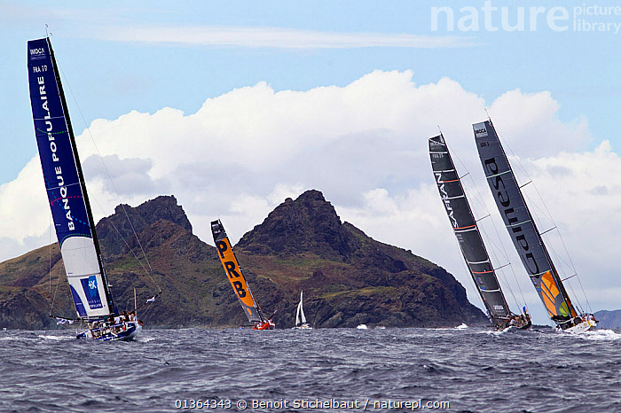 Fleet racing at the beginning of the Transat BtoB, St Barthelemy, Caribbean, December 2011. All non-editorial uses must be cleared individually.  ,  BOATS,CARIBBEAN,CHOPPY,COASTS,FLEETS,HEELING,IMOCA ,ISLANDS,LANDSCAPES,MAINSAILS,OPEN 60,RACES,RACING,REAR VIEWS,SAILING BOATS,SOLO,TRANSAT,WEST INDIES,WIND,YACHTS,SAILING-BOATS,Weather  ,  Benoit Stichelbaut