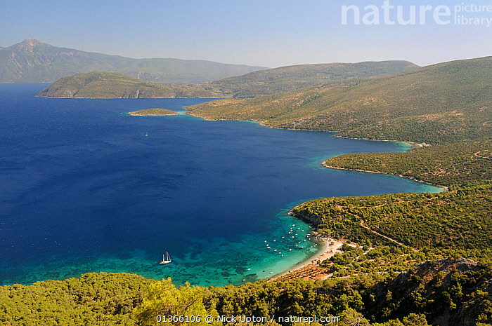 Mourtia beach and bay with the southeast tip of Samos and Mount Mycale in Turkey's Dilek Peninsula National Park in the background, east coast of Samos, August 2011.  ,  aegean,bay,BEACHES,BLUE,catalogue4,coastal,COASTS,Dilek Penninsula,elevated view,EUROPE,FORESTS,GREECE,idyllic,ISLANDS,LANDSCAPES,MEDITERRANEAN,Mount Mycale,Mourtia beach,Nobody,NP,PEACEFUL,Republic of Turkey,RESERVE,sailing boat,Samos,Scenic,sea,SKY,travel destination,TREES,TURKEY,WATER,YACHTS,National Park,PLANTS,BOATS  ,  Nick Upton