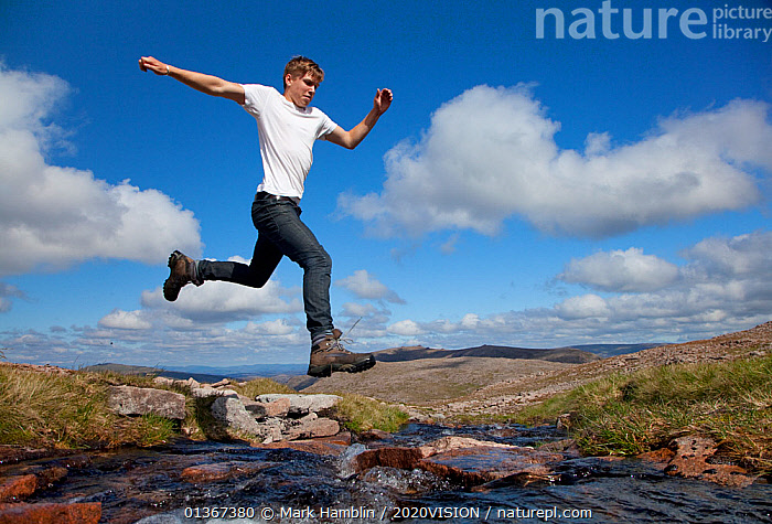 Boy (aged 17) jumping across upland stream, Cairngorms National Park, Highlands, Scotland, UK, August, Model released. 2020VISION Exhibition. 2020VISION Book Plate. Did you know? More than a million people visit the Cairngorms National Park every year., 2020VISION,2020vision book plate,2020vision exhibition,ACTION,ENJOYMENT,EUROPE,exhibition,fun,hill,JUMPING,LANDSCAPES,LEAPING,MAN,MOUNTAINS,nature,picday,NP,outdoors,PEOPLE,play,playing,RIVERS,SCOTLAND,scottish uplands,STREAMS,SUMMER,teenager,UK,UPLANDS,WATER,National Park,Communication,United Kingdom,2020cc, Mark Hamblin / 2020VISION