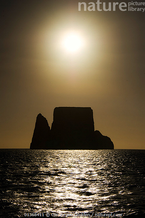 Kicker rock in silhuette. San Cristobal, Galapagos  ,  ARTY SHOTS,BLACK AND WHITE,GALAPAGOS,GALAPAGOS ISLANDS,ISLANDS,LANDSCAPES,PACIFIC ISLANDS,SEAS,SEASCAPES,SILHOUETTES,SKIES,SUN,VERTICAL,SOUTH-AMERICA  ,  Ole Jorgen Liodden