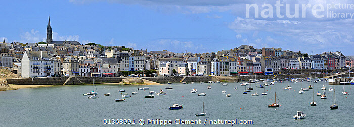 Seafront with sailing boats in the harbour of Douarnenez, Finistere, Brittany, France May 2011  ,  BOATS,BUILDINGS,COASTAL WATER,COASTS,CRUISING,EUROPE,HARBOURS,LANDSCAPES,MARINE,MIXED BOATS,MOORED,MOTORBOATS,PANORAMIC,SAILING BOATS,SEA,URBAN,YACHTS  ,  Philippe Clement