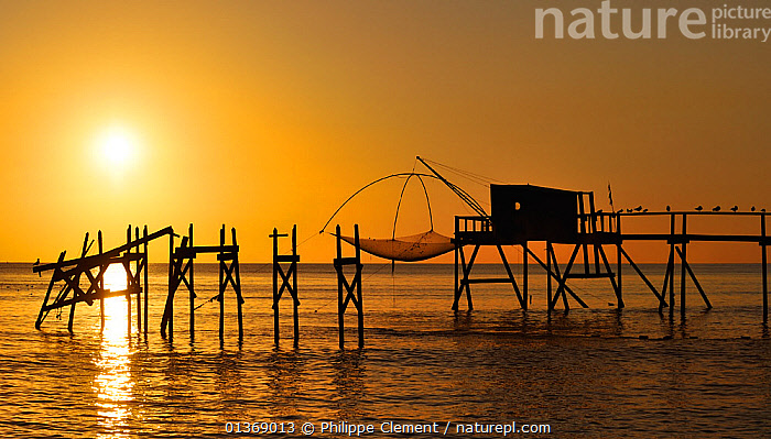 Traditional carrelet fishing hut with lift net on the beach at sunset, Loire-Atlantique, Pays-de-la-Loire, France September 2011  ,  COASTAL,COASTS,DUSK,EUROPE,EVENING,FISHING,HUNTING,LANDSCAPES,MARINE,NETS,SEA,SILHOUETTES,SUNSET,TRADITIONAL  ,  Philippe Clement