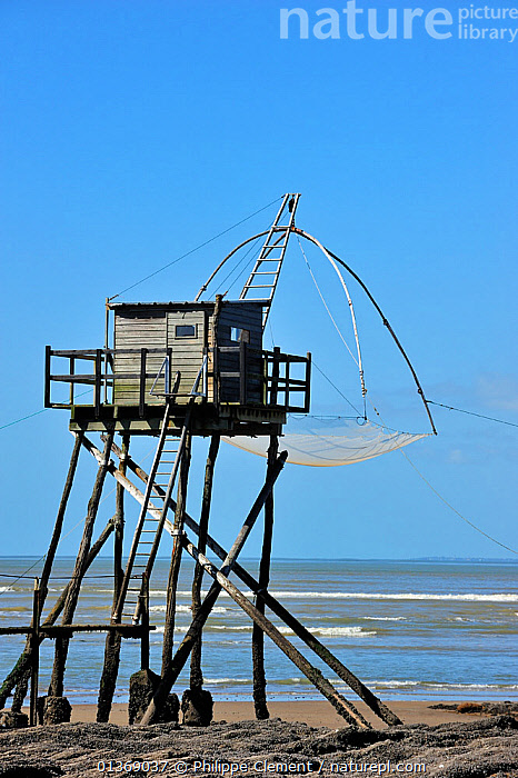 Traditional carrelet fishing hut with lift net on the beach at Saint-Michel-Chef-Chef, Loire-Atlantique, France September 2011  ,  COASTAL,COASTS,EUROPE,FISHING,HUNTING,LANDSCAPES,MARINE,NETS,SEA,TRADITIONAL,VERTICAL  ,  Philippe Clement